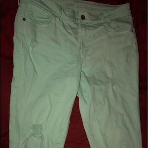 Greenish ripped jeans